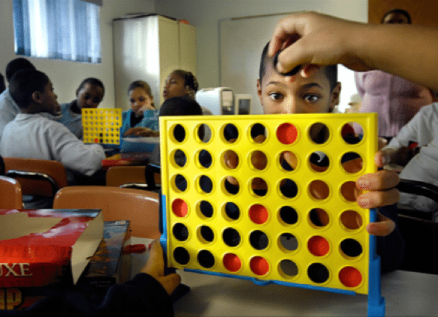Kids playing Connect Four