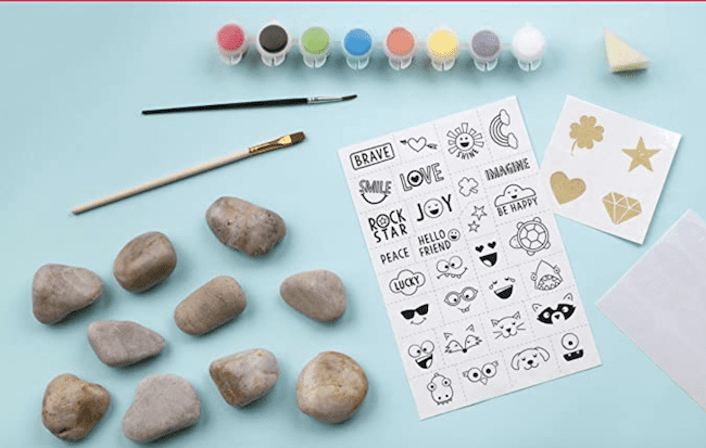Rock painting kit that is used to play hide and seek outside, as an example of educational outdoor toys