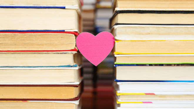 Heart between two stacks of books