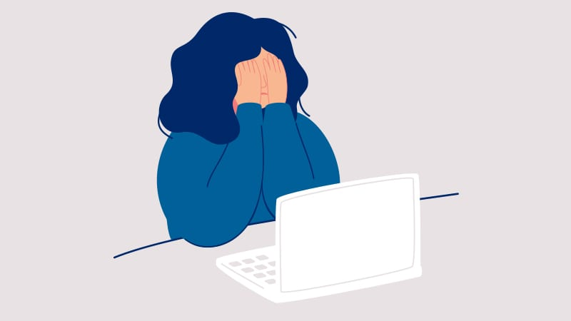 Illustration of a frustrated teacher looking at her computer.