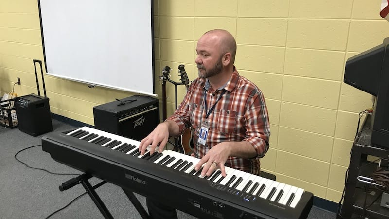 Music teacher plays keyboard as part of Carnegie Hall Musical Explorers program