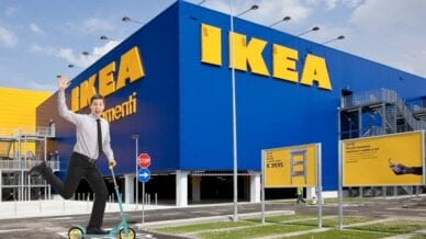shot of a man on a scooter outside of an iKEA warehouse