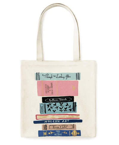 Kate Spade tan tote bag with books on it