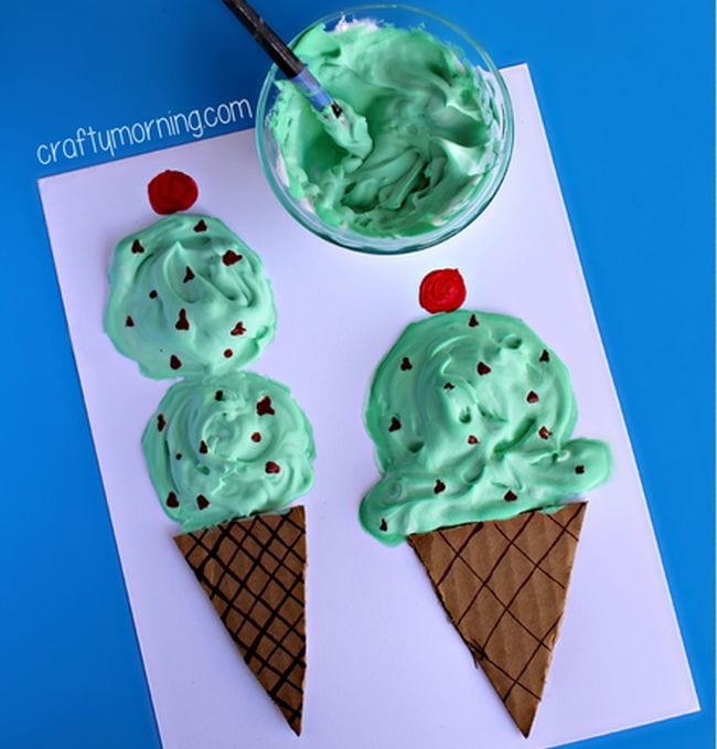 Paper ice cream cones topped with shaving cream dyed green