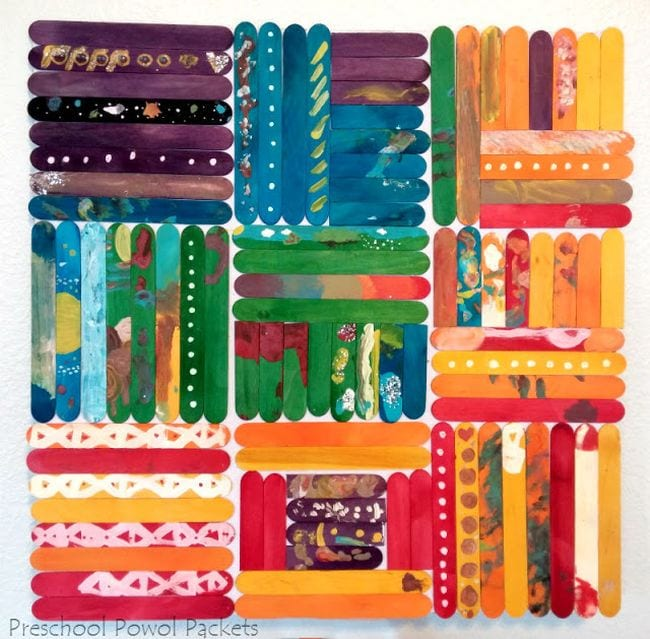 Wood craft sticks painted in vibrant colors and arranged in squares