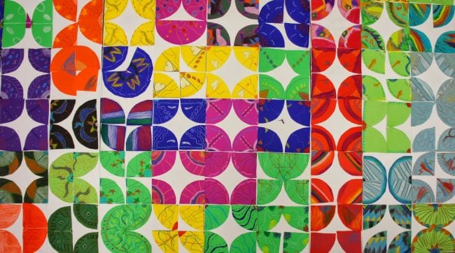 Colorful paper quilt squares made with circle designs (Kindergarten Art)