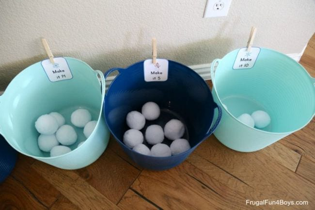 Three large plastic bins with artificial snowballs in each (Kindergarten Math Games)