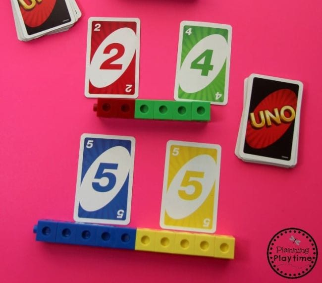 UNO cards with math cubes representing the numbers shown (Kindergarten Math Games)