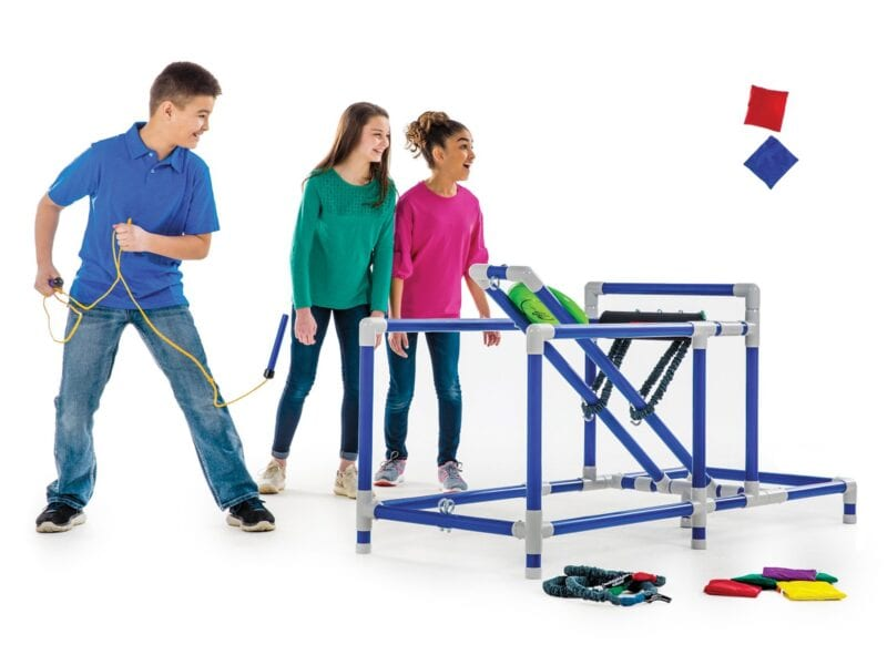 students conducting a science experiment using a catapult