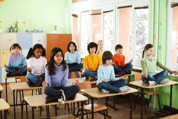 Students meditating at desks