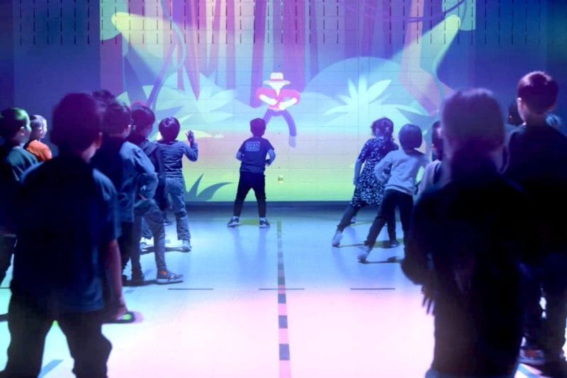 Kids using Lu in P.E. class to dance