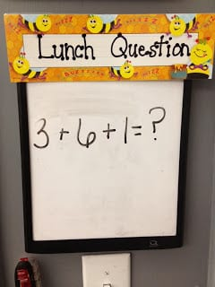 """Exit tickets: whiteboard with """"lunch question"""" that says 3+6+1=?"""