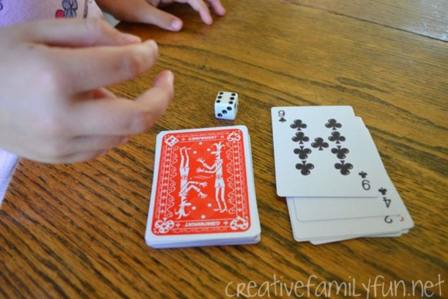 Student with a deck of cards and die