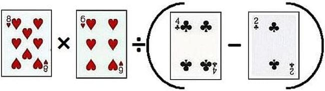 Playing cards laid out to create a math equation with multiplication, division, and parentheses