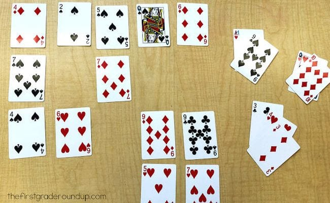 Playing cards laid out face up with some grouped to add up to 10