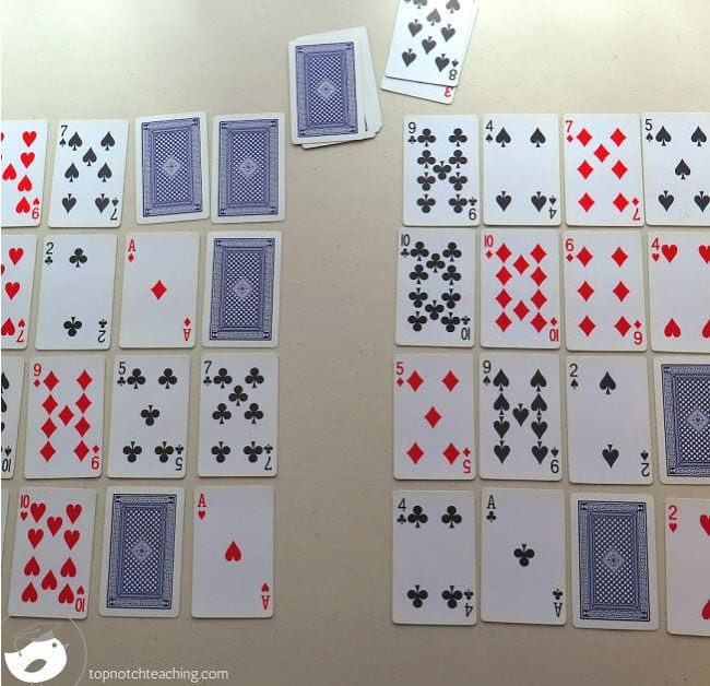 Playing cards laid out in rows, with some face up and some face down (Math Card Games)