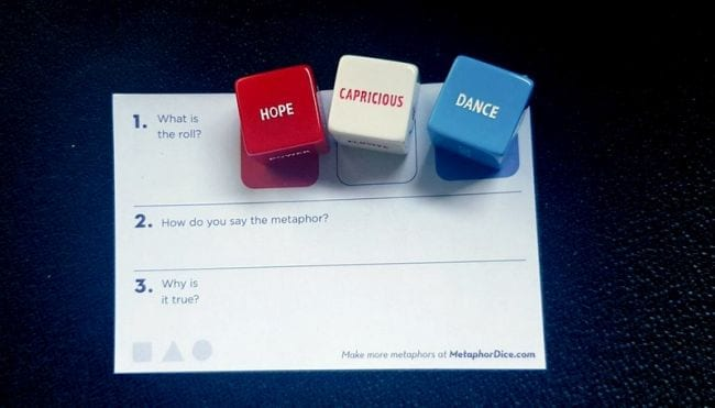 Metaphor dice with words written on each side