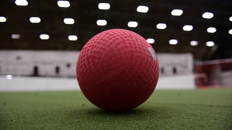 Cherry ball on an indoor field.