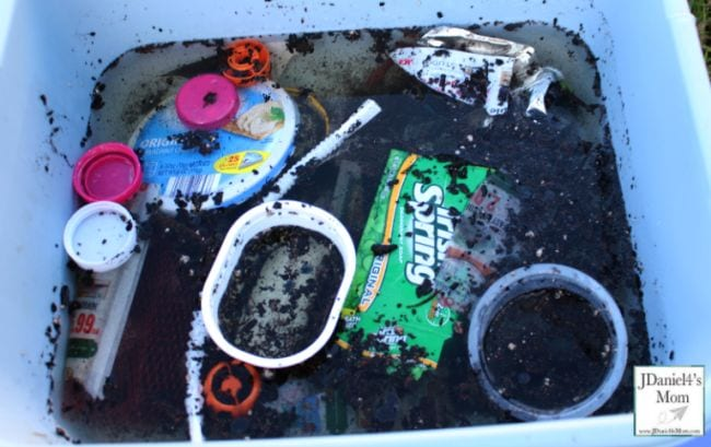 Plastic bin full of filthy water and litter (Outdoor Science)
