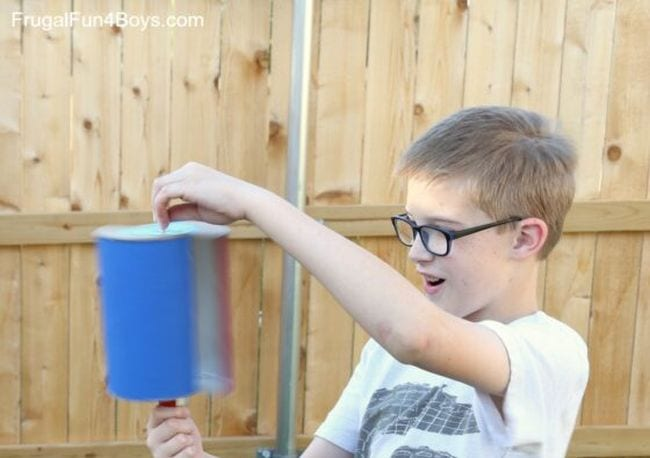 Student holding a homemade wind turbine (Outdoor Science)
