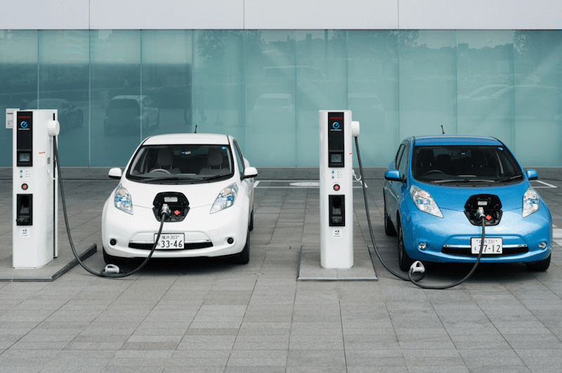 Two Electric Cars Charging - Earth Day Activities