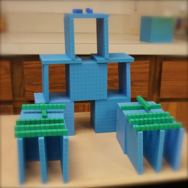 Base 10 blocks stacked into towers and other structures (Place Value Activities)