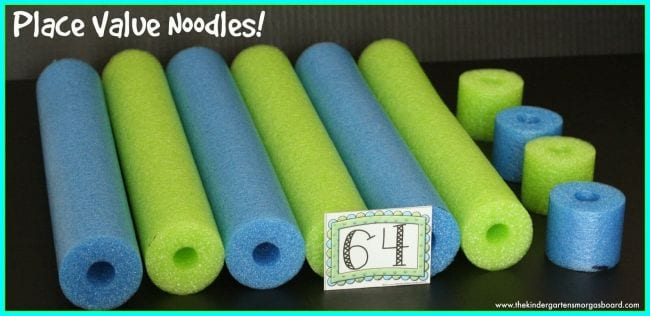 Blue and green pool noodles cut into long and short pieces, with card saying 64 (Place Value Activities)