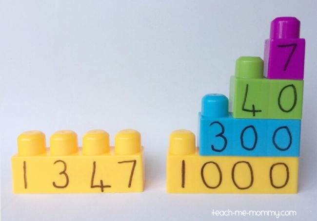 LEGO DUPLO bricks with numbers written on the sides under each peg (Place Value Activities)