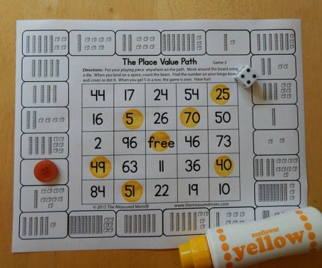 Printable board game labeled The Place Value Path with dice and yellow bingo dauber