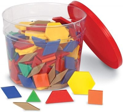 Plastic colored shapes in a tin.