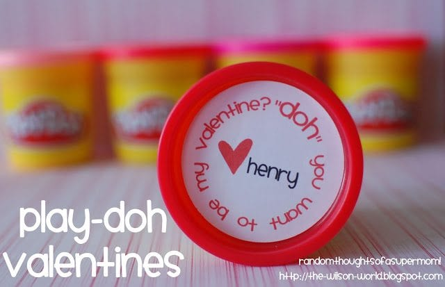 """Containers of play dough with close up of one cover that says, """"''Doh' you want to be my valentine?"""""""