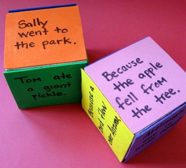 Large cubes with dry-erase surfaces, with clauses written on each side