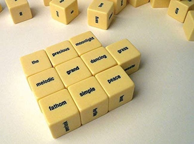 Cubes with words on each side, arranged to form a haiku (Poetry Games and Activities)