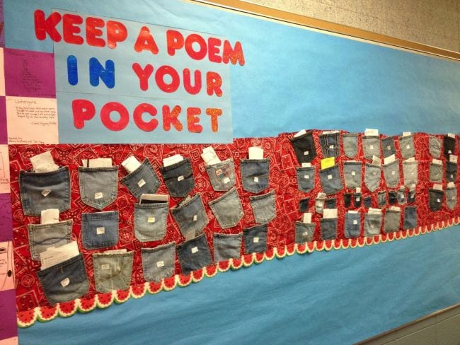 Keep a Poem in Your Pocket bulletin board with denim pockets full of paper slips (Poetry Games and Activities)