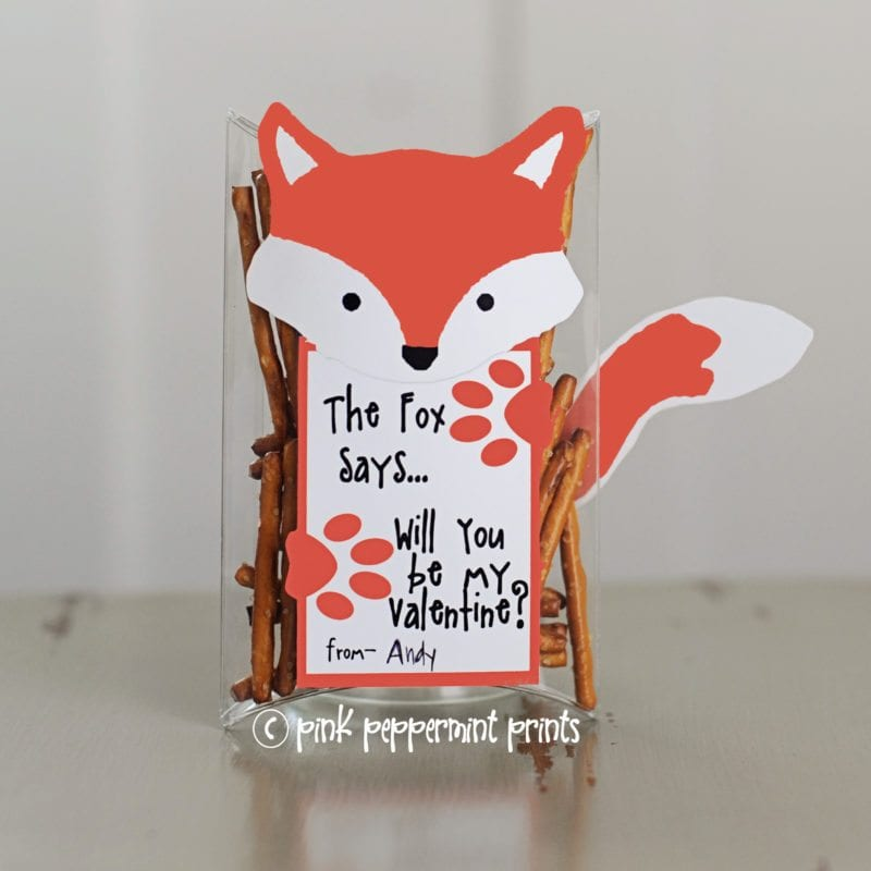 """Clear plastic box containing pretzel sticks and a fox-shaped card that says, """"The fox says, will you be my valentine?"""""""