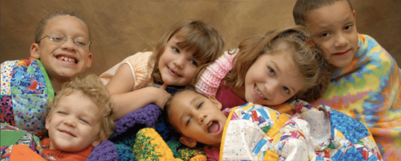 Kids with blankets care of Project Linus