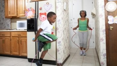 A Mother and Son Jump Roping in their Home
