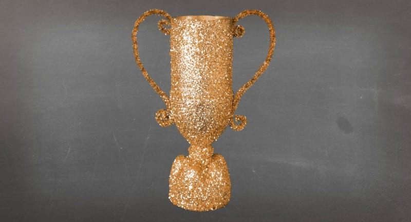 Adding glitter to the spray painted water bottle trophy
