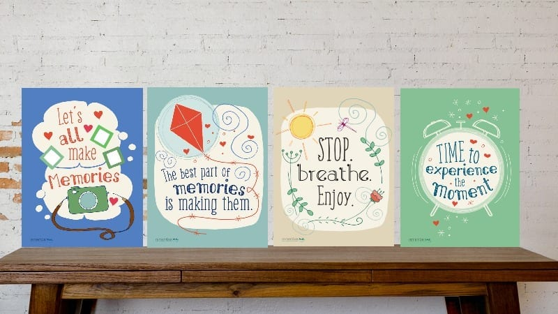 Four yearbook posters on a wooden bench