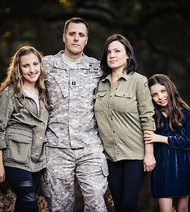Kenzie Hall founder of Brat Pack 11 with father in military uniform, mother, and younger sister