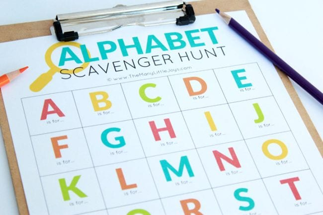 Alphabet scavenger hunt printable on a clipboard with a pencil