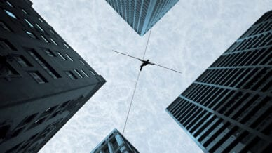 A picture of a teacher walking on a tightrope as schools can't be the only safety net.