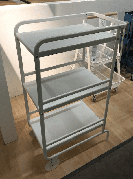white 3-tiered storage cart with wheels on one side