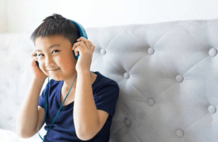 Student putting on headphones.
