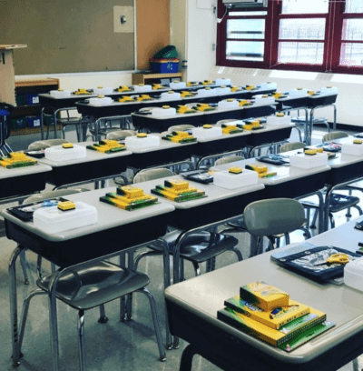School supplies stacked on every desk ready for students on the first day of school.