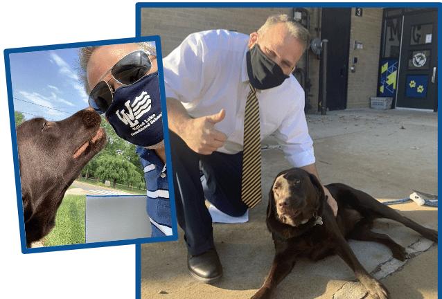 Principal Mark Hess with his dog Champ
