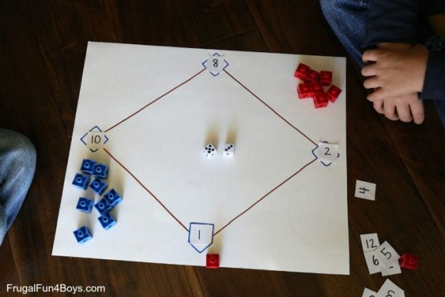 Baseball diamond drawn on a large piece of paper, with numbers at each base and red and blue markers (Second Grade Math Games)