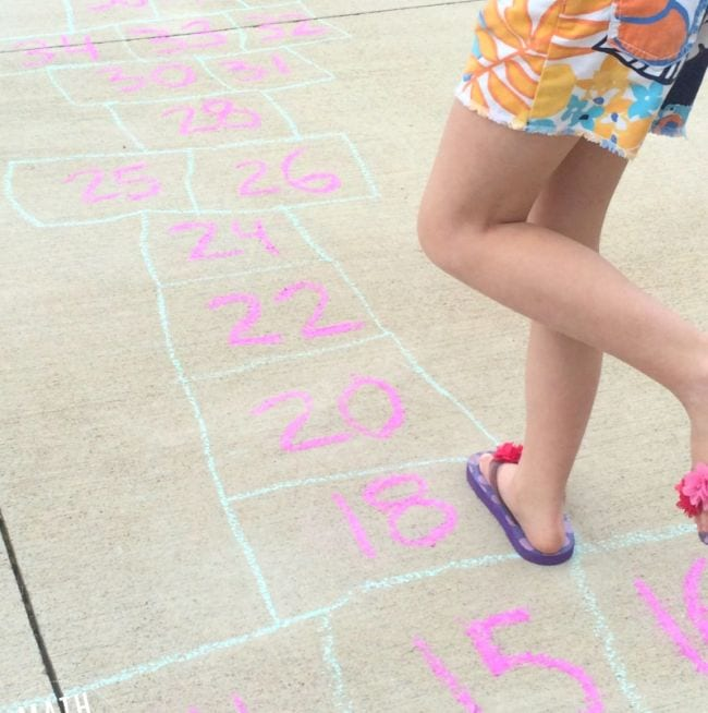Second grade math student playing hopscotch