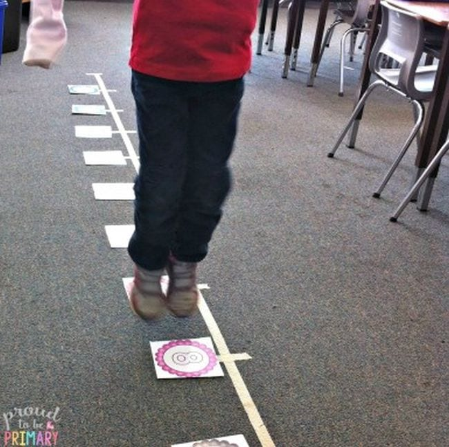 Second grade student hopping along a life-size number line