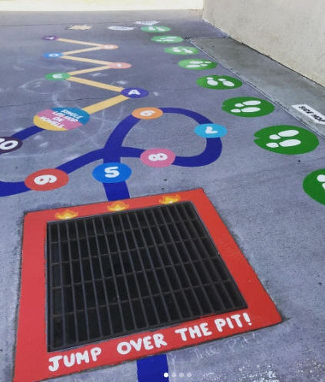 """Drain grid marked """"jump over the pit"""" as part of a larger sensory path"""